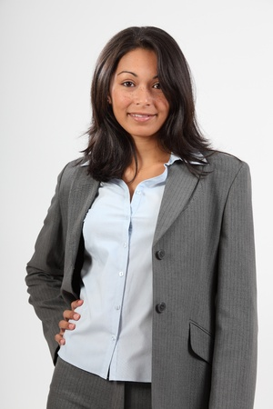 Young business lady in grey suit photo