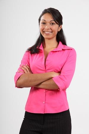 Beautiful young woman wearing pink shirt smiling