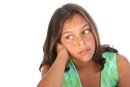 Teenage girl beautiful brown eyes leaning on hand looking away photo