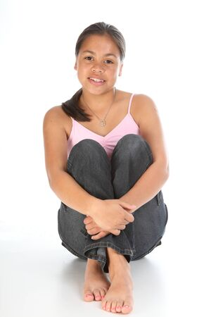 knees up: Teenager girl sitting with knees up in studio