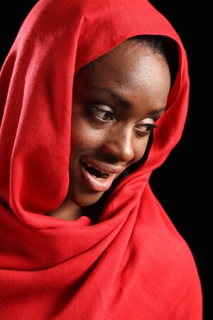 Headshot fo beautiful young black african american muslim girl wearing red hijab, with a happy smile on her face. photo
