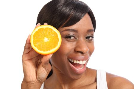 Big happy smile and excited fun pose with orange slice by beautiful young black woman. Stock Photo - 9747002