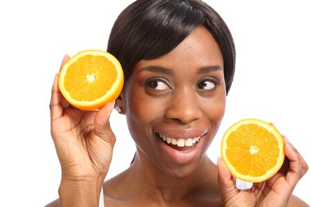 Healthy food promoted with happy smile with orange slice by beautiful young black woman. Stock Photo - 9747008
