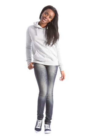 black sweater: Happy smile from beautiful young black student girl, wearing grey hoodie sweater and blue jeans. Girl has long hair. Stock Photo