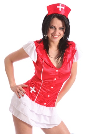 Beautiful young caucasian model wearing a sexy red and white fancy dress nurse costume. Model has big happy smile on her face. photo