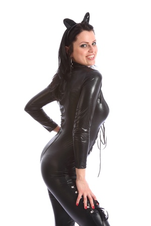 fancy dress costume: Curvy figure of sexy young caucasian woman wearing a black skin tight pvc cat suit complete with ear head piece. Model is striking a fun cat pose with a big happy smile.