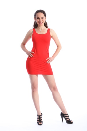short dress: Beautiful, sexy female fashion model, wearing black high heel shoes and a short red dress. Full length against white background. Stock Photo