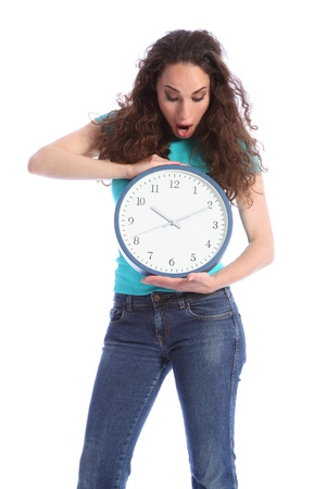 turqoise: Surprised at the time, a beautiful young woman holding a large clock. She has long brown hair and is wearing blue jeans and turqoise t-shirt.