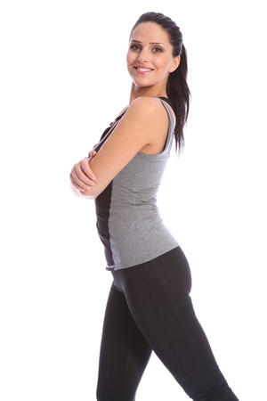 Fit beautiful and young athletic woman standing in a relaxed pose with arms folded, big smile and wearing a grey and black sports outfit. Stock Photo - 10034242