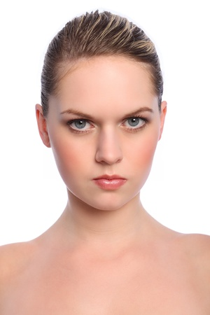 hair back: Headshot of beautiful young caucasian girl with bright blue eyes and blonde hair, with natural make up for a cosmetics beauty look. Stock Photo