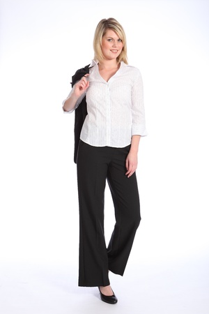 Confident and smiling in business suit, a full body shot of beautiful young blonde business woman, standing with her coat over her shoulder in a casual pose. photo