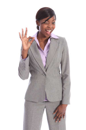 blouse: Positive okay hand sign by beautiful young ethnic african american business woman with a big smile and winking one eye.