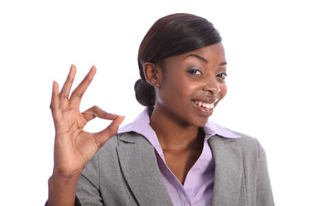 Positive okay hand sign by beautiful young ethnic african american business woman with a big happy smile. Stock Photo - 10252601
