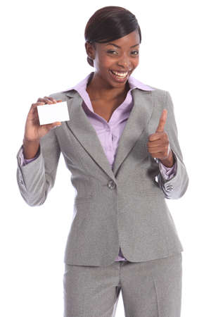 Positive thumbs up sign by beautiful young ethnic african american business woman with a big happy smile, holding a business card in other hand. Stock Photo - 10252604