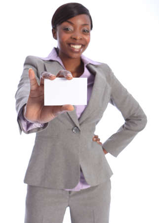 Beautiful young ethnic african american business woman with a big happy smile, holding out a business card. Model is blurred in background with card in sharp focus close to camera. photo