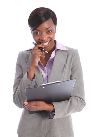 Cute smile from beautiful young ethnic african american business woman holding clipboard and black pen. photo