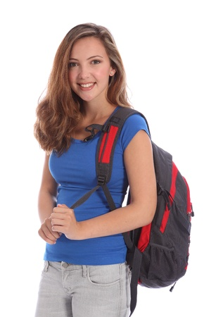 Beautiful young teenager school girl 16, with long brown hair wearing blue t-shirt and school backpack with big happy smile. Studio shot against white background. Zdjęcie Seryjne