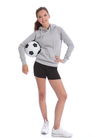 Tall slim soccer player teenage girl with happy smile wearing sports clothes, standing in casual pose with ball. Full length shot against white background.