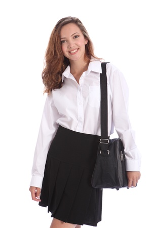Happy smile from beautiful teenage student girl wearing black and white school uniform with school bag over her shoulder.