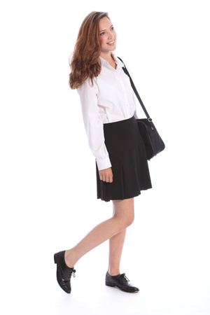 school uniform girl: Smile from beautiful teenage secondary school student girl wearing black and white school uniform, holding on to her bag.