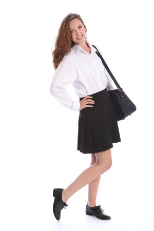 Beautiful smile from young teenage secondary school student girl wearing black and white school uniform, with bag over her shoulder. Stock Photo - 10382701
