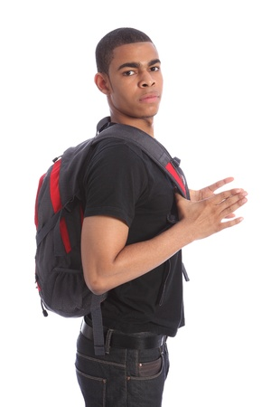 Young handsome teenage African American student wearing jeans and t-shirt, standing with school backpack. Stock Photo - 10382707