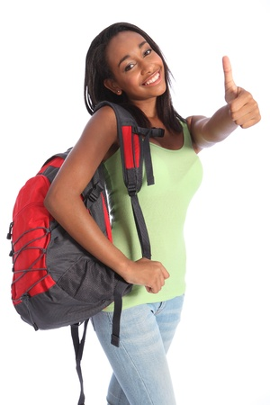 Thumbs up happy success for pretty young African American teenager school girl, with long black hair wearing green t-shirt and red school backpack with beautiful smile. Stock Photo - 10389754