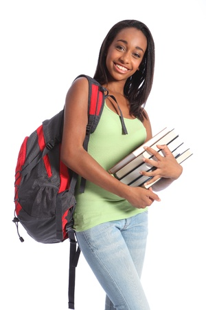 successful student: Pretty young African American teenager student girl with big smile wearing red backpack and holding school books. She has long black hair and wearing green vest and blue jeans.