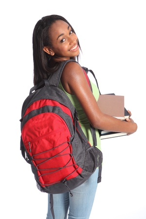 Time for education from pretty young African American teenager high school student girl with big beautiful smile wearing red backpack and holding study books. Stock Photo - 10389760