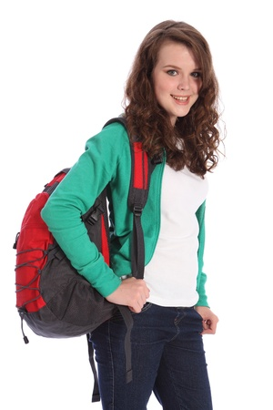 secondary school student: Pretty young teenager school girl, with long brown hair wearing green jumper and red school backpack with big happy smile. Studio shot against white background.