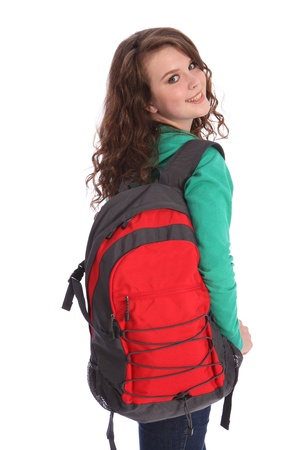 Pretty young high school teenager girl, with long brown hair wearing green jumper and red school backpack with big happy smile. Studio shot against white background. Stock Photo - 10429855