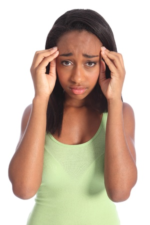 headaches: Painful headache for young african american girl, holding her hands to temples with hurt showing on her face. Shot against white background.