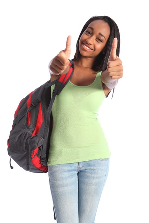 Two thumbs up in double happy success for pretty young African American teenager school girl, with long black hair wearing green t-shirt and red school backpack with beautiful smile. Stock Photo