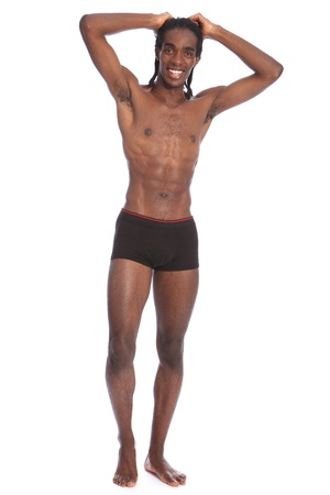 Happy smile to go with fit healthy toned body of handsome young African American man wearing black underwear only, standing showing off slim torso and abdominal muscles. photo