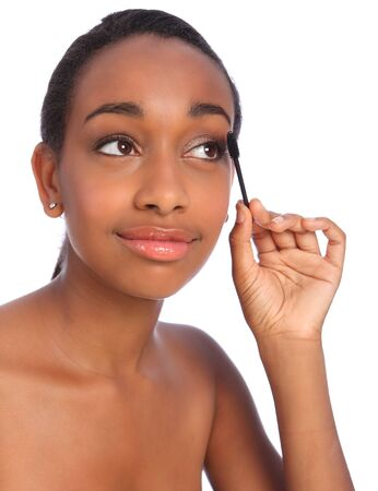 Beautiful young african american make up artist woman using mascara brush, also known as a mascara wand. Stock Photo - 10526745