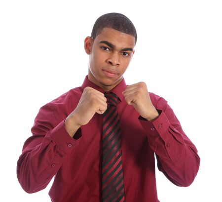 smartly: Tough in business concept for smartly dressed good looking young African American man with fists raised in fighting stance. Wearing red shirt and necktie.