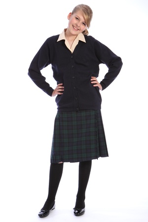 Happy smile from beautiful teenage high school student girl wearing school uniform, tartan skirt and beige shirt with navy cardigan. photo