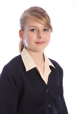 school uniform girl: School picture with a smile from beautiful teenage student girl in school uniform. Stock Photo