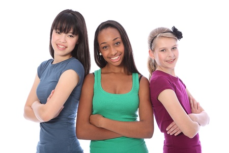 diverse teens: Three multi cultural teenage school student friends made up of mixed race african american, oriental Japanese and caucasian all happy and smiling together.