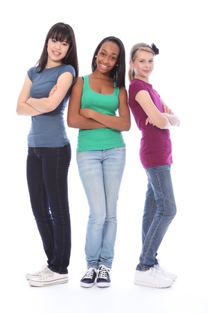 Three multi cultural teenage school student friends made up of mixed race african american, oriental Japanese and caucasian all happy and smiling together. Stock Photo - 10782730