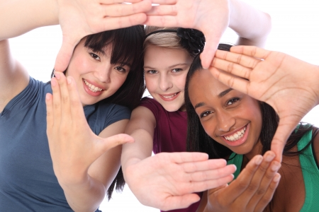 youth group: Fun hand sign by three multi cultural teenage school student friends made up of mixed race african american, oriental Japanese and caucasian all happy holding hands out to camera.