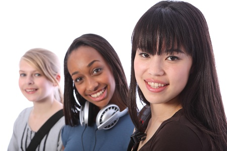Beautiful young Japanese student girl with two other multi ethnic teenage friends, a mixed race african american and blonde caucasian girl, all with happy smiles. Stock Photo - 10782735