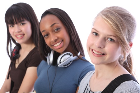 multi cultural: Pretty young blonde caucasian student girl with two other multi ethnic teenage friends, an oriental Japanese and African American mixed race girl, all with happy smiles.