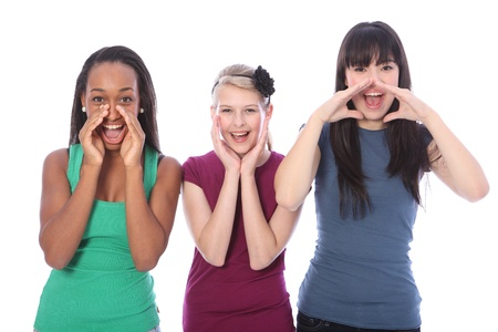 Shouting out loud are three pretty young teenager girl friends a blonde caucasian student, an oriental Japanese and an African American mixed race girl, all with happy smiles. photo