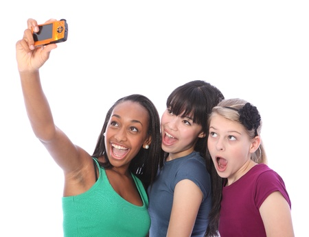 Using digital compact camera taking fun self portrait photograph for three pretty young teenager girl friends a blonde caucasian, an oriental Japanese and an African American mixed race student. Stock Photo - 10782759