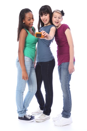 Fun photography with digital camera for three pretty young teenager girl friends a blonde caucasian, an oriental Japanese and an African American mixed race student all having a laugh together. Stock Photo - 10782763