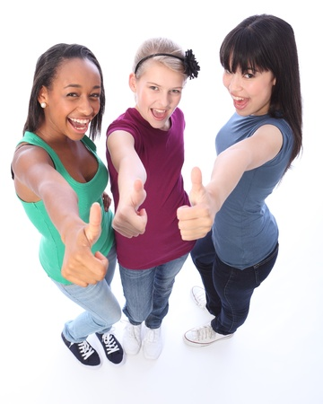 Excited thumbs up in success by three multi cultural teenage school student friends made up of mixed race african american, oriental Japanese and caucasian all happy holding hands out to camera. photo