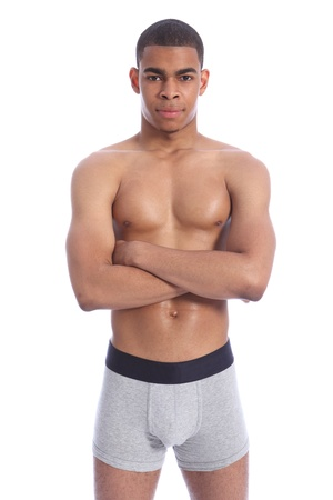 half naked: Fit healthy toned body of handsome young African American man wearing grey jockey underwear only, naked upper torso showing off pectoralis muscles.