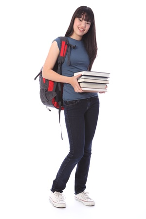 secondary school student: Carrying education books a beautiful smiling young Japanese teenager high school student girl wearing blue denim jeans and t-shirt, backpack over her shoulder. Stock Photo
