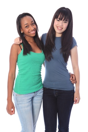 Two happy beautiful teenage friends, a mixed race african american and oriental Japanese girls with big smiles and long black hair.